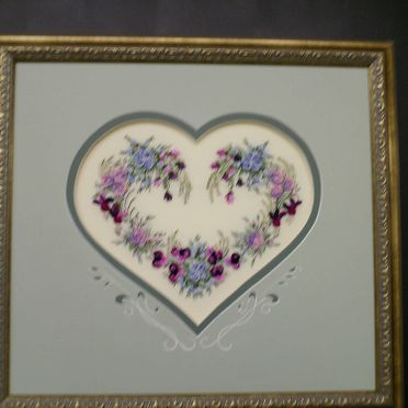 heart shape niddle art in frame